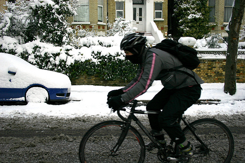 Snowy cyclist, with slush
